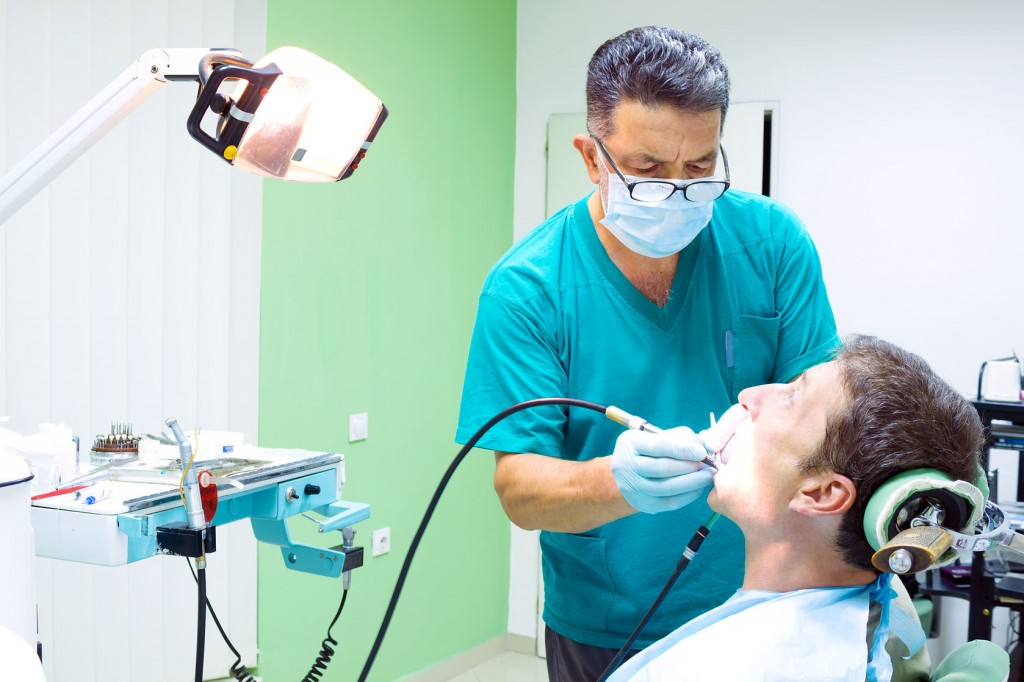 44932409 - dentist fixes the patient's teeth, photography
